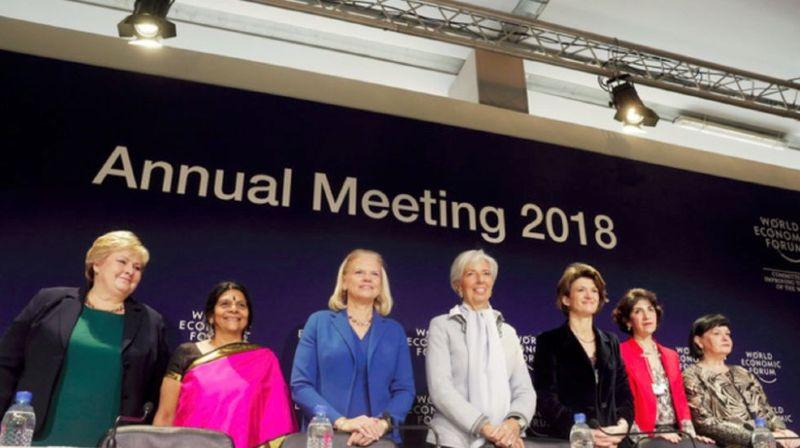Les sept co-présidentes du WEF 2018, avec, de gauche à droite: Erna Solberg, Première ministre de Norvège, Chetna Sinha, présidente de la fondation Deshi, Ginni Rometty, PDG chez IBM, Christine Lagarde, directrice du FMI, Isabelle Kocher, CEO d'ENGIE, Fabiola Gianotti, directrice générale du CERN et Sharan Burrow, secrétaire générale de la Confédération Syndicale Internationale.