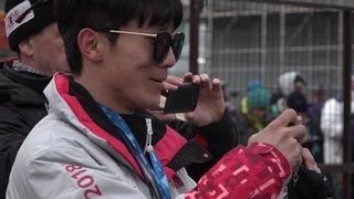 Les fans de Cologna avec cloches et cors des Alpes en Corée