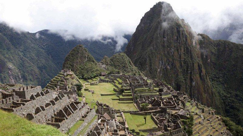 La citadelle de Machu Picchu est visitée chaque année par des milliers de touristes.