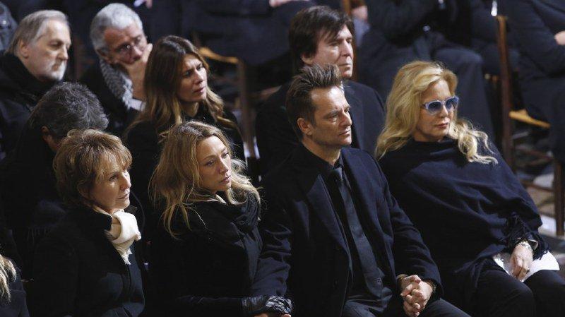 Laura Smet et David Hallyday (au centre) ont obtenu le gel d'une partie des revenus générés par la vente des disques de leur père Johnny Hallyday.