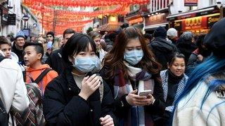 Coronavirus: la Chine se barricade, des étrangers attendent l'évacuation